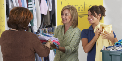 Women helping with clothing donations